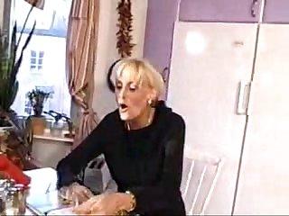 Blonde mature fucked in the kitchen