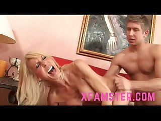 Blonde cougar sucks up to young big dicks to get a hard long fuck
