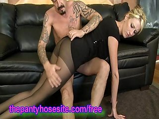 Hottie in pantyhose gives a footjob