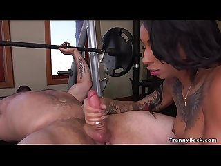 Tattooed tranny fitness instructor fucks guy