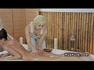 Masseuse rubs babe with massage tool