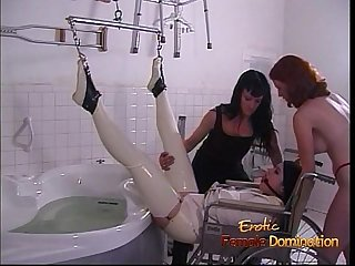 Latex clad stunner pleasures her ass with a toy before receiving an enema