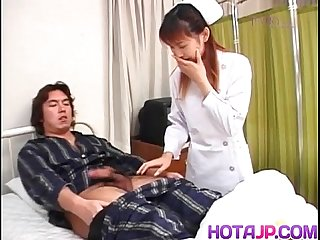Nurse is touched on cans while stroking patient cock