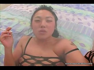 Nasty asian slut smoking while sucking dick and in fishnet lingerie