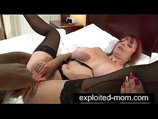Mature milf with big tits doing black guy