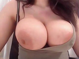 Slutty milf showing boobs with milk on cam