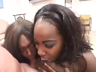 Sexy ass black bitches on floor blowing hot white cock