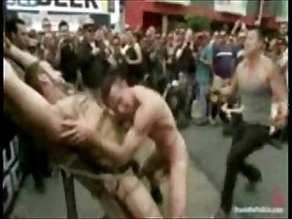 Sick crowd playing with tied up boy