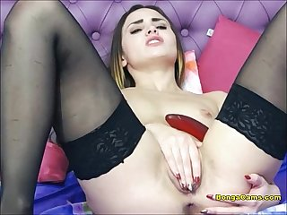 Cute cam girl pleasuring her cunt with big red dildo
