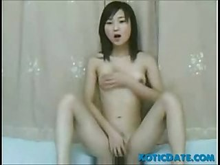 Young Asian Girl Plays with her Pussy - XoticDate.com