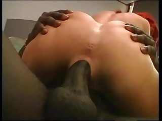 Redhead woman dilated by a huge black dick in the ass!