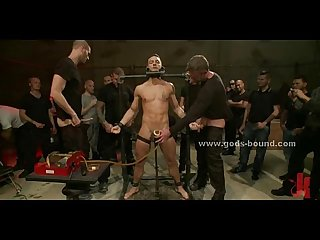Sexy gay boy cuffed in leather fucked in extreme bdsm fetish gang bang video