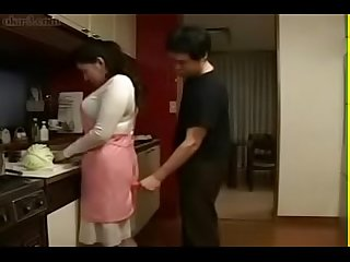 Japanese mother an son in kitchen fun