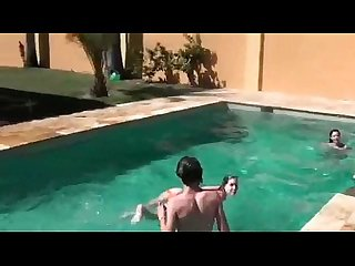 Horny college girls stripping naked in the pool