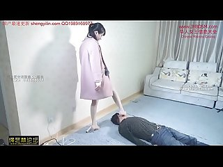 chinese mistress tramples her slave all over his body and neck