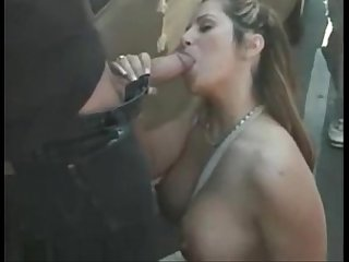 Horny cougar doing blowjob in outdoors