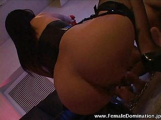 Hot mistress in fishnets pours hot candle wax on her slaves' back
