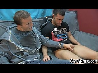 Two jocks give each other handjobs and blowjobs