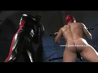 Men are bound in leather and dominated