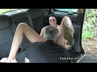 Natural busty brunette bangs in fake cab and outdoor