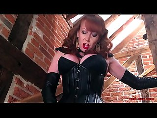 Redheaded Mistress Plays With Her New Toy