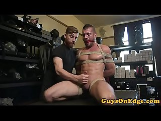 Bound bdsm sub spreadeagle for cock jerking