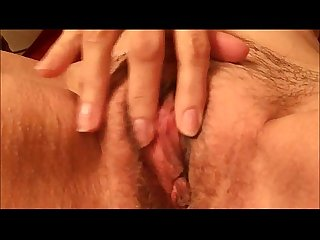 Granny pleasing her hairy pussy - closeup