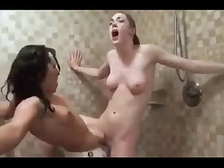 Lesbians fucking with a strap on in the shower