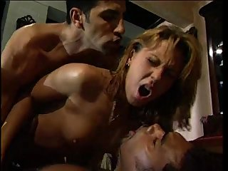Sweet blonde banged on a table by two colored guys