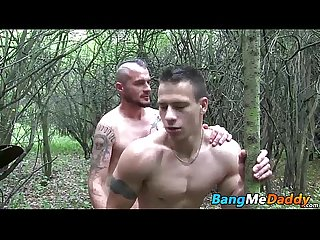 Two horny guys sucking each others cocks deep in the woods